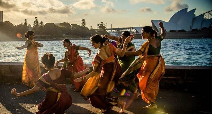 Women dancing at cultural festival on sydney harbour