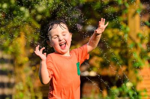 Kid in the sprinkler