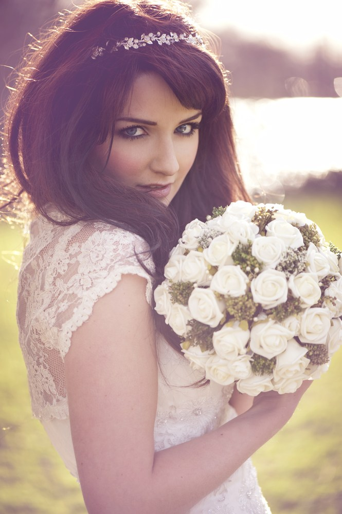 Bashful bride with white bouquet