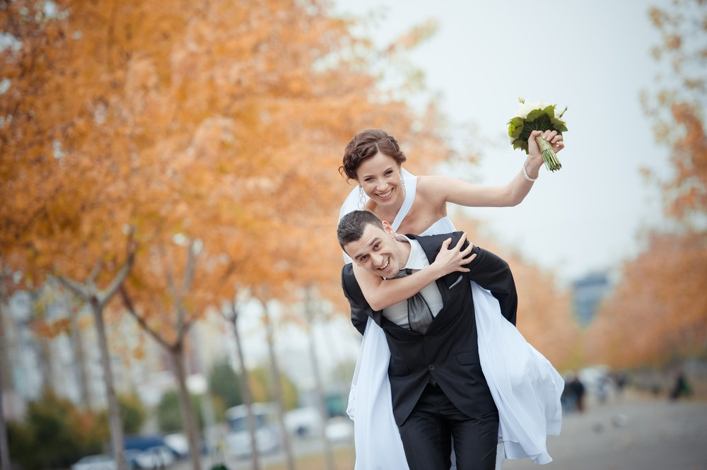 Couple piggyback - just married