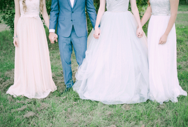 Bride and groom holding hands with bridesmaids