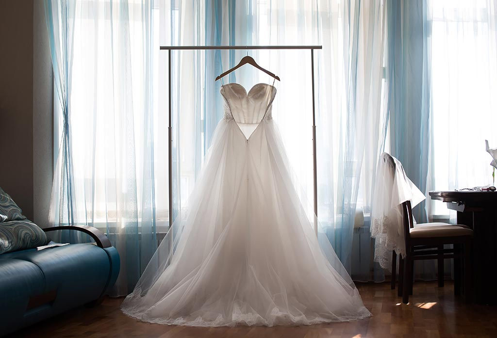 Wedding dress hanging infront of window