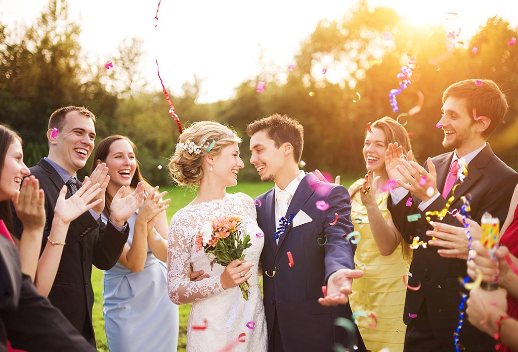 Just married couple surrounded by guests