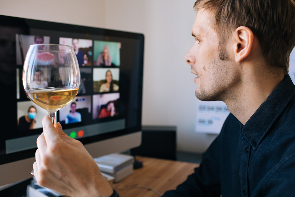Man throwing virtual party to stay connected