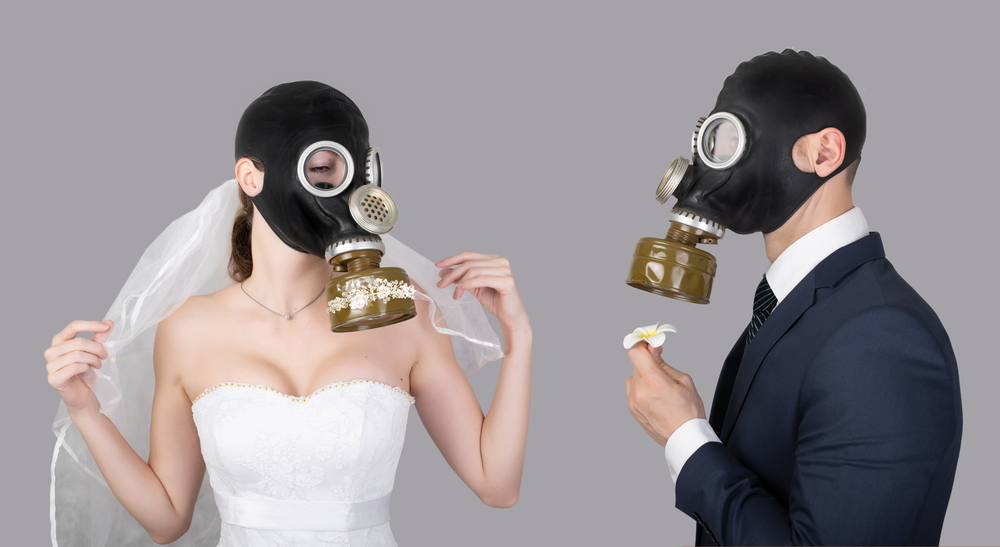 bride and groom in gas masks